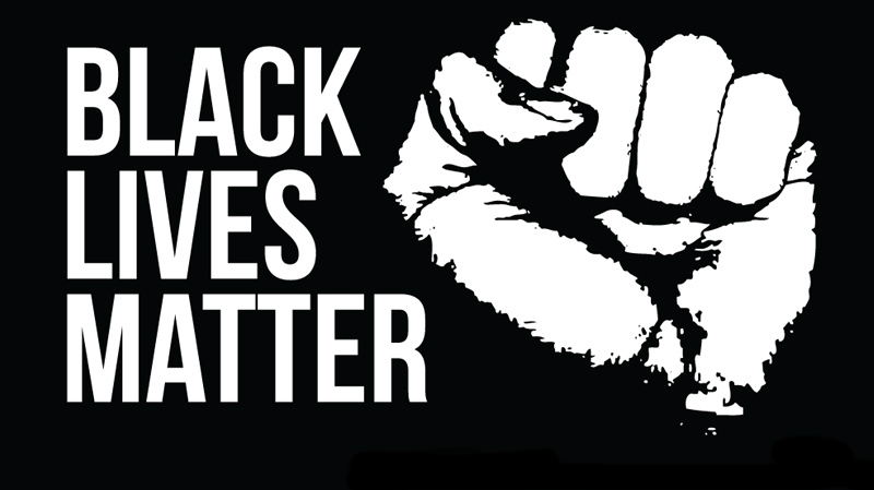 A closed fist with the words 'Black Lives Matter'